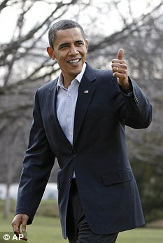 Fit for duty: Barack Obama signals a thumbs-up when asked about his health as he returns to the White House from the National Naval Medical Centre after his check-up