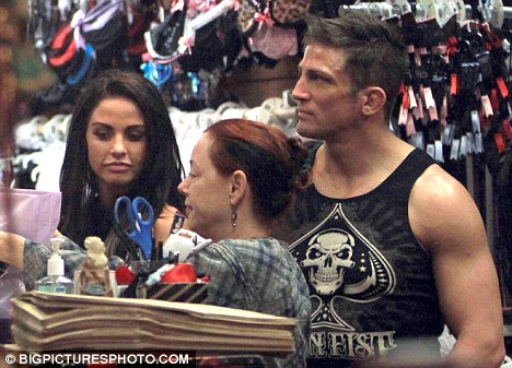 Trashy: Katie Price and Alex Reid are pictured on a visit to the Trashy Lingerie store in Los Angeles