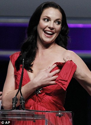 Disaster: The actress couldn't finish her speech as she battled with the broken strap