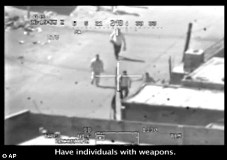 A still from a video shot from a U.S. army Apache helicopter showing a group of men in the streets of eastern Baghdad just prior to being fired upon