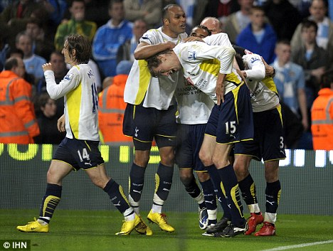 Golden goal: Crouch is mobbed by his jubilant Spurs team-mates after his late header secures fourth spot