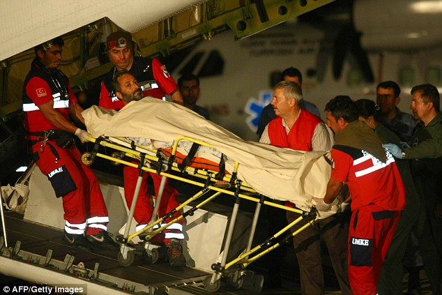 Wounded: An injured activist is helped from the plane and taken to a hospital in Ankara, Turkey