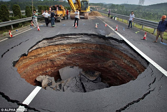 Common: A truck overturned and its driver was injured after a hole appeared in a motorway in Zheijiang Province