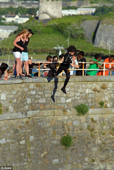 Dare devils: Children as young as 12 make the potentially fatal  65-foot leap