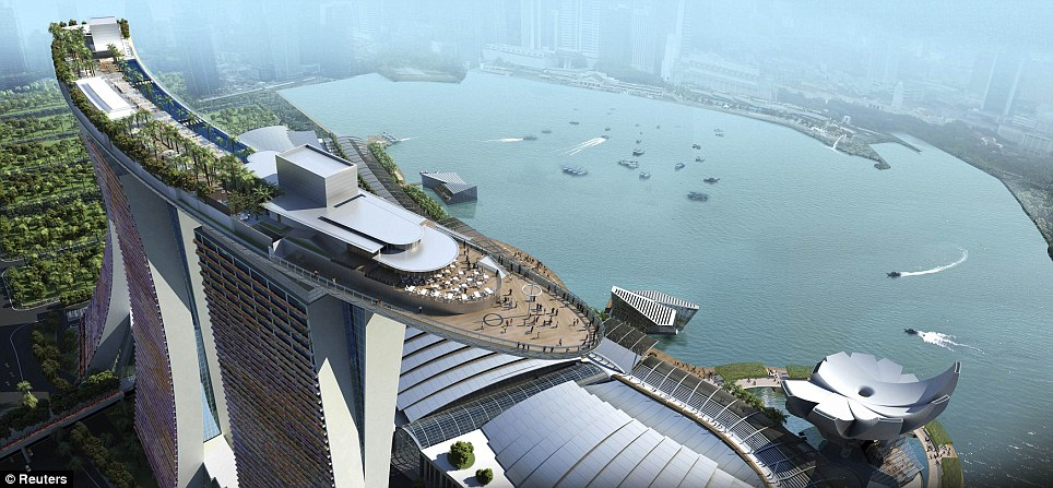 The view over the side: An artist's impression shows the Skypark that tops the Marina Bay Sands hotel towers, including the infinity pool