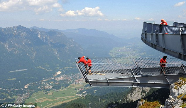 Workers make finishing touches to the AlpspiX viewing platform in Garmisch-Partenkirchen, southern Germany