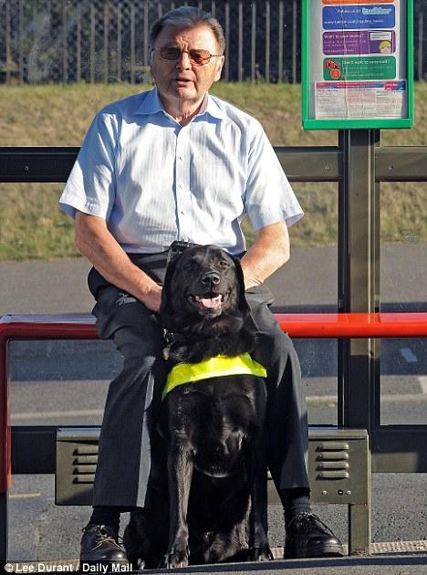 George Herridge and his guide dog