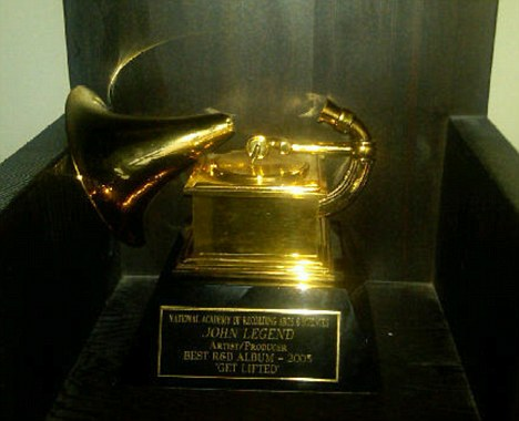 Image result for images of a broken grammy award