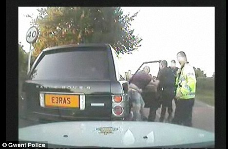 The video shows a policeman climbing onto the bonnet before Mr Whatley is dragged out of his car