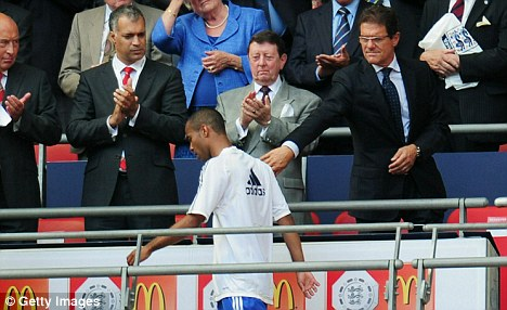 Cole shoulder? the Chelsea left-back appears to ignore Capello's hand at Wembley