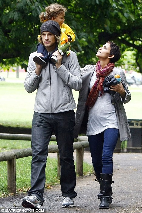 Doting dad: Model Gabriel carries Nahla on his shoulders as they visit a park together