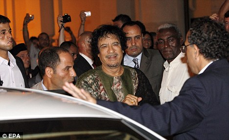 Pledge: The Libyan leader was celebrating the two-year anniversary  of an agreement with Italy which has promoted development in the  African country