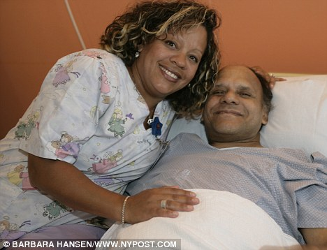 I recognise you: Nurse Wanda Rodriguez poses with her long-lost  father Victor Peraza today