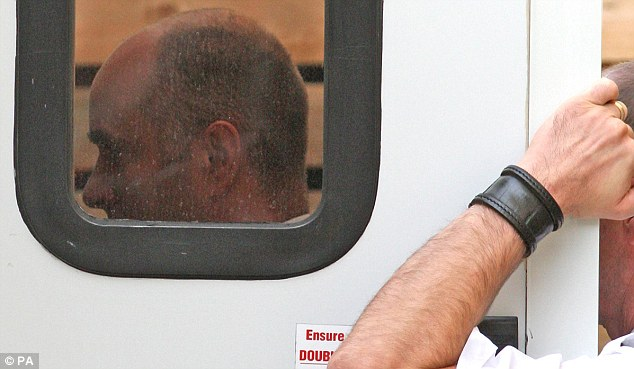 Off to jail: Sgt Andrews, left, is lead into the back of a prison  van at the rear of Oxford Magistrates Court