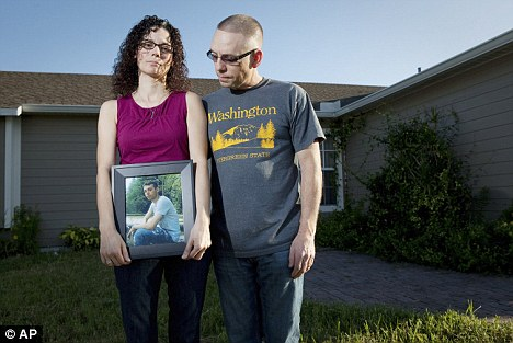 Accused: Emma and Christopher Winfield's son Adam, 22, tried to to  tell the Army about the civilian killings