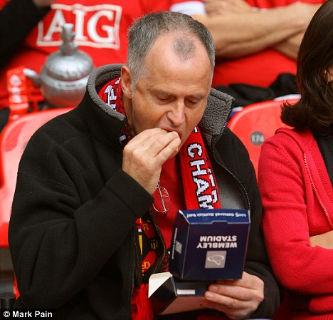 Manchester United fan eating a burger at the new Wembley Stadium, during the FA Cup Final Chelsea v Manchester United
