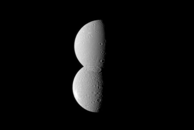 Looking like half of a figure eight, two of Saturn's moons appear conjoined in this Cassini spacecraft imageCassini spacecraft image