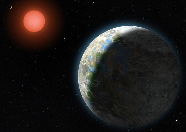 This artist's conception shows the inner four planets of the Gliese 581 system and their host star, a red dwarf star only 20 light years away from Earth