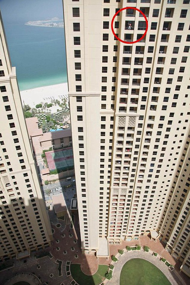 Hell for leather: A window cleaner takes his life into his own hands on the 34th floor of a Jumeirah Beach apartment block