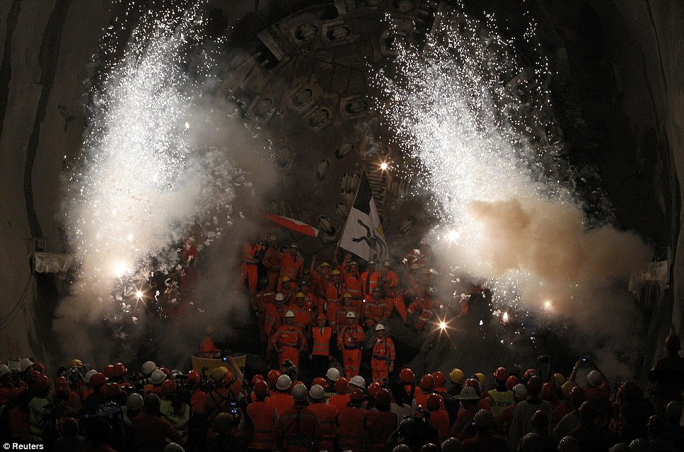 Celebration: The tunnel has taken 14 years of digging - 23 years overall - and will not be ready until 2017