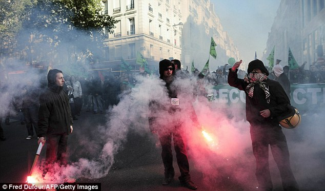Rail workers hold flares on October 21, 2010 in Paris as part of nationwide rallies against French government's pensions reform