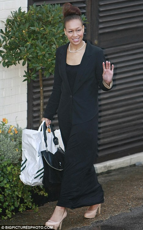 Give us a wave: Rebecca Ferguson arrived looking fresh-faced and make-up free, apart from a slick of lip gloss
