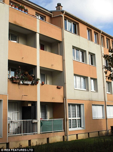 Baby: Twelve people in Paris suburb jumped from their second-floor balcony to escape 'the devil' - and one infant died in the fall