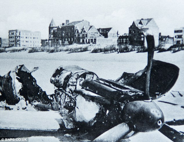 A wrecked British fighter plane lies mangled on the beach at Dunkirk
