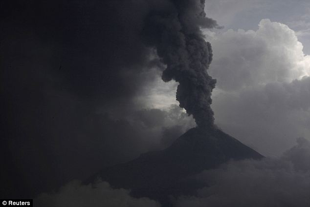 Eruption: Mount Merapi spews out towering clouds of gas and debris