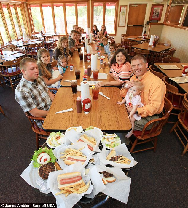 Feeding the five thousand: The family fill up half a restaurant when they go out on in Lake city, Tennessee - and their own dining table is so large Dad Gil says he can't hear what's going on at the far end