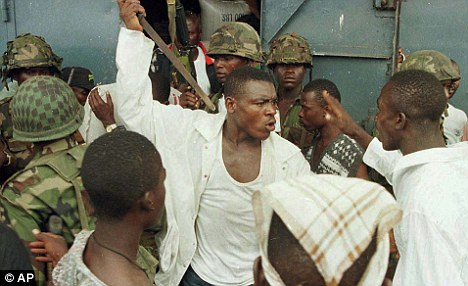 General Butt Naked: Joshua Milton Blahyi threatens a fellow fighter with a knife in May 1996