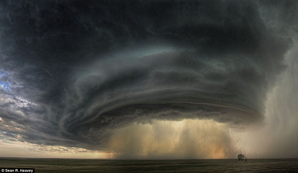 Awe: This massive supercell shows a column of rain in the centre of thick clouds