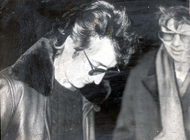 Fateful meeting: Lennon signs a copy of his Double Fantasy album for Mark David Chapman, who would be waiting for the star six hours later in the same spot - outside New York's Dakota apartments building