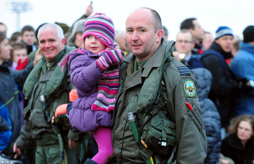 That's my daddy: Wing Commander Simon Jessett with daughter Sophie after the emotional ceremony