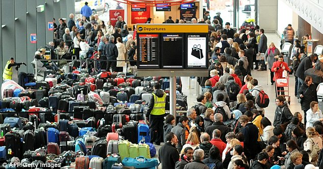 Passengers waiting at Heathrow's Terminal 3