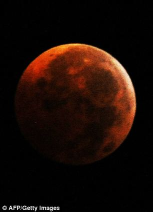 A total eclipsed moon is seen from Silver Spring, Maryland,