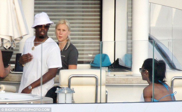 Life at sea: Sean 'Diddy' Combs relaxes on a rented yacht with ex-girlfriend Kim Porter (right) off the coast of St Barts in the Caribbean