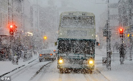 Arctic conditions: A bus tries to make its way through Tunbridge Wells, Kent, as bad weather sweeps across the country