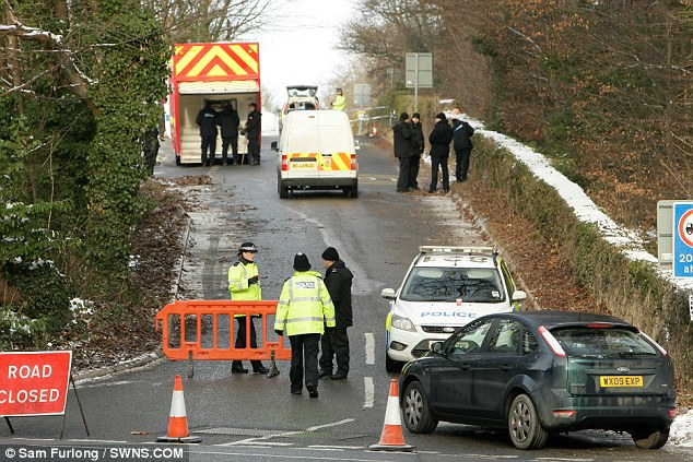 Police search Longwood Lane near Bristol where Joanna Yeates' body was found yesterday by dog walkers