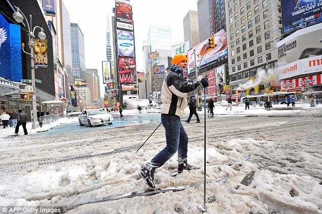 Going off-piste: A man who gave his name as Marcus cross-country skis through Times Square after the blizzard yesterday