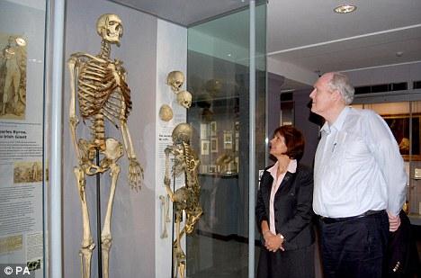 Gigantic genes: Brendan Holland (right) observes the skeleton of 'Irish Giant' Charles Byrne, who shares the same mutant gene