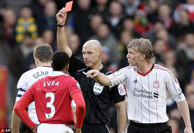 Red midst: Liverpool are reduced to ten men after referee Howard Webb sends Steven Gerrard off after a reckless challenge on Michael Carrick