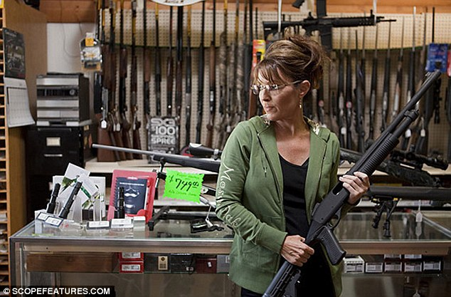 Poster girl for the gun debate: Sarah Palin buys a gun at a shop in Wasilla, Alaska, in a scene from her reality show, Sarah Palin's Alaska
