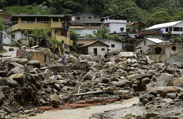 Utter devastation: People pick their way among the debris