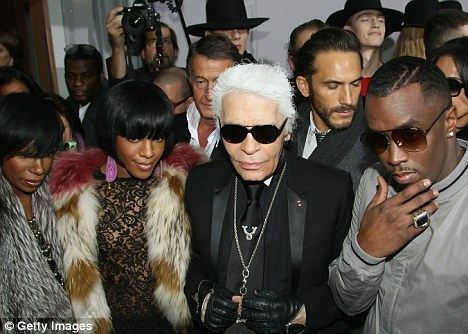 In style: P Diddy with Karl Lagerfeld and his Dirty Money backing singers Kalenna Harper and Dawn Richards at the Dior Homme show at Paris Menswear Fashion Week today