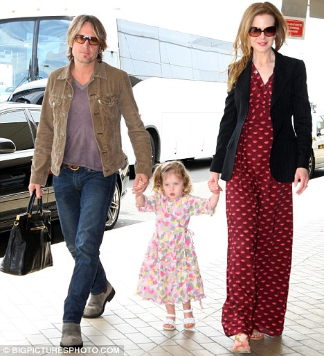 Healing experience: Having daughter Sunday Rose (pictured) and new baby Faith with husband Keith Urban has bought Nicole happiness