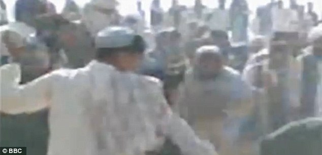 Mob: The crowd continued to throw stones at the couple even after they slumped to the floor