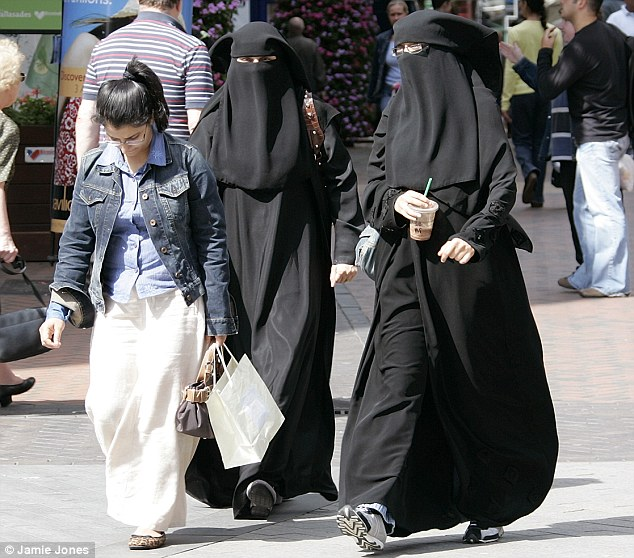 On the rise: Nearly one in ten people in Britain will be Muslim by 2030 because of immigration and high birth rates. The report comes amid continuing debate over the views of Muslims in Britain and attitudes towards them