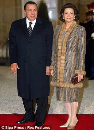 Big bucks: President Hosni Mubarak with his wife Suzanne, who is half-Welsh and has a British passport