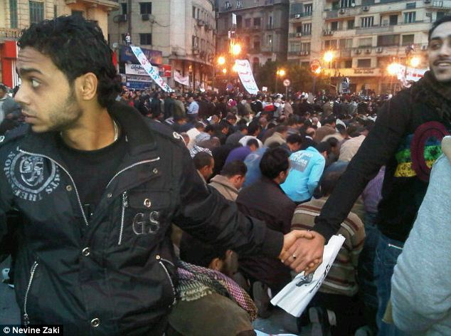 Christians faced outward and joined hands in a circle to protect a Muslim group of protesters as they prayed in Egypt